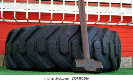 Tire and sledgehammer