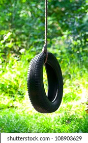 Tire swing hanging in park