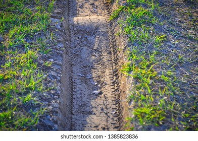 Tire track in mud. At the grassroots level.