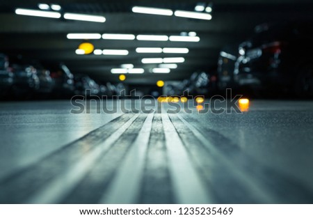 tire track underground parking garage shallow stock photo edit now Parking Garage Elevator tire track in an underground parking garage shallow d o f