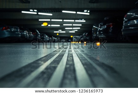 tire track underground parking garage full stock photo edit now Parking Garage at Night tire track in an underground parking garage full of cars shallow d o f