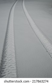 Tire tracks in newly fallen snow; Sierra Foothills of Northern California.