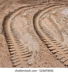 Tire tracks on a muddy road in the countryside, Routing traffic in the countryside,