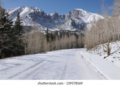 Tire tracks on a snow covered mountain road.