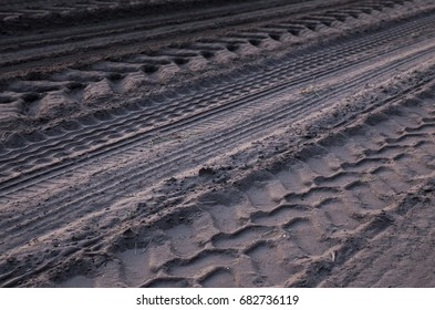 tire tracks in the sand of multiple vehicles off road