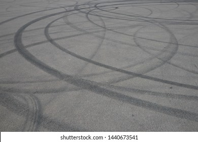 tire tracks. wheel track on asphalt road. asphalt with traces of car wheels. Traces of braking from rubber tyres on cement. Abstract road background with tracks of tires