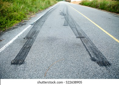 tire tracks, which brakes suddenly on the asphalt road and turn off the white line.abs system