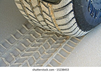Tire Tread and Imprint on Sand