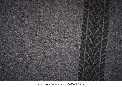 tire tread pattern on asphalt background
