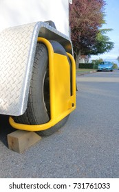 A tire wheel choke or wheel lock is used to ensure a trailer or vehicle attachment can not be stolen.