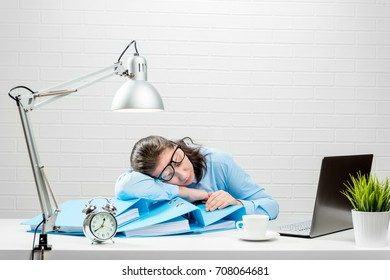 Tired accountant during the reporting period works overtime at night