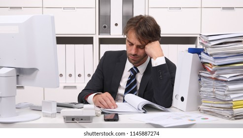 Tired Accountant Man Sleeping on Stack Folders after Exhausted Day at Work in Bookkeeping Office Room
