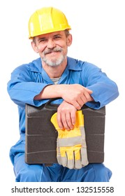Tired adult worker with toolbox has a rest sitting over white background