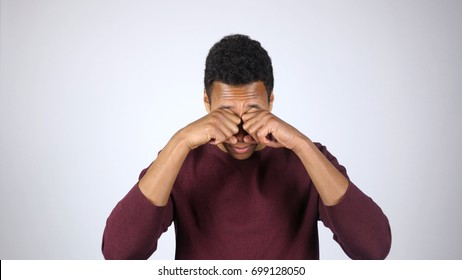 Tired Afro-American Man Rubbing Eyes, White Background