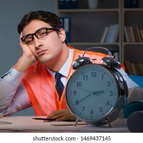 Tired architect working late long hours under stress to meet dea