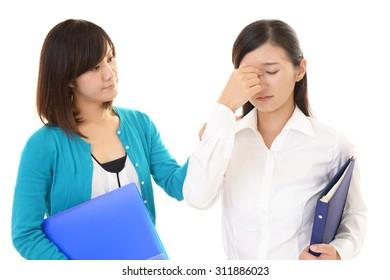 Tired Asian business women