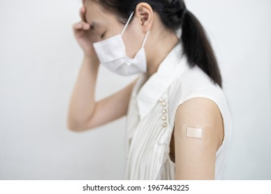 Tired asian child girl with a fever,headache,fatigue,dizziness,allergic reactions to the COVID-19 vaccine after injection,side effects of receiving medicine to prevent Coronavirus,vaccination concept