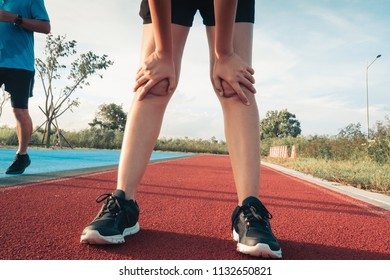 Tired athlete runner is exhausted of cardio workout on running track., Healthcare and sport concept.