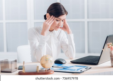 tired attractive business woman working at the desk in the office