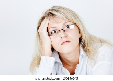 Tired of attractive young blond woman in glasses. portrait
