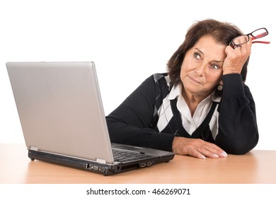 Tired beautiful senior woman with laptop isolated in white