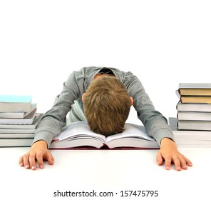 Tired and bored boy sleeping among the books