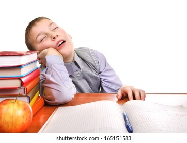 Tired Boy Sleeping on the School Desk on the white background