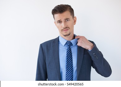 Tired Business Man Feeling Hot and Pulling Collar