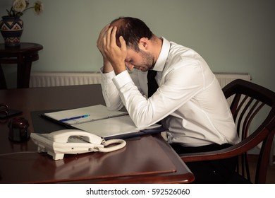 tired business man sitting at table