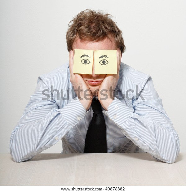 A tired business man sleeping