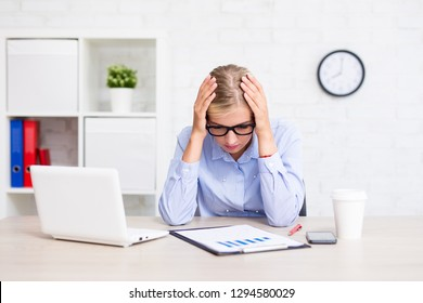 tired business woman sitting in modern office