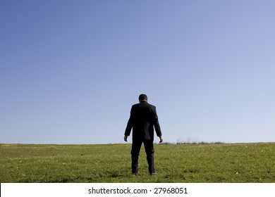 tired businessman after walking in the field