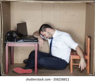 Tired businessman asleep in the office