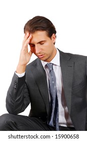 Tired Businessman having a headache and holding his forehead