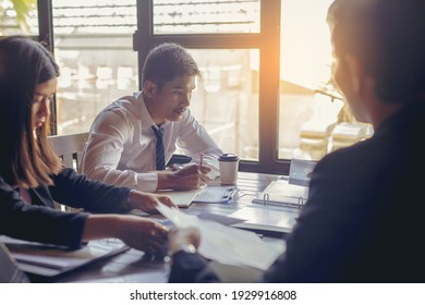 Tired businessman in meeting to discuss the situation on the market with hard working. Analyzing marketing data for start up new business project.