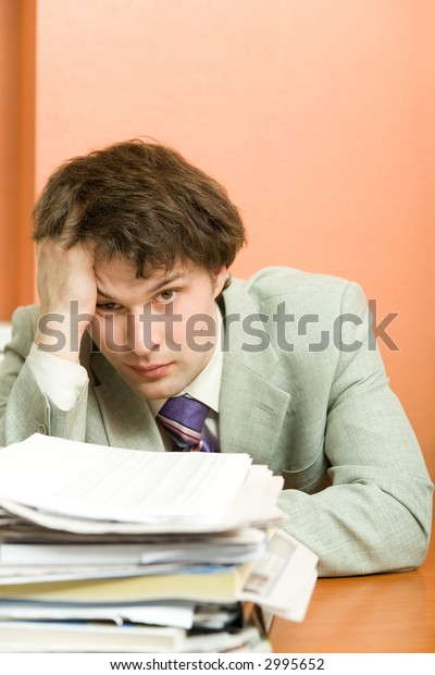 A tired businessman in the office, vertical