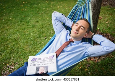 Tired businessman resting in nature