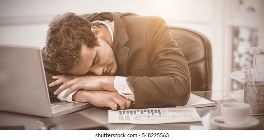 Tired businessman sleeping in his office