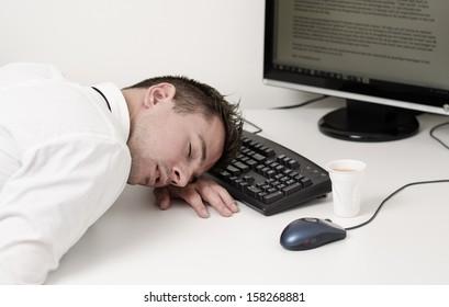tired businessman sleeping on computer