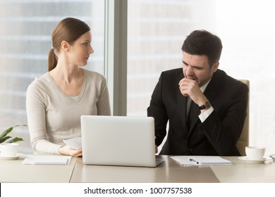Tired businessman yawning when sitting at desk with female colleague during meeting in office, businesswoman looking with confusion on bored male coworker. Lack of sleep and narcolepsy, bad manners