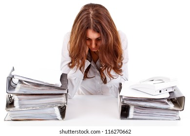 Tired businesswoman with unfinished paperwork