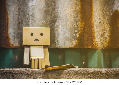 I'm so tired. Danbo toy on sitting on the wall