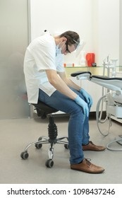 Tired dentist in his office waiting for patient