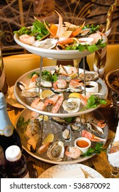 Tired dish with fish and mussels stands on dinner plate