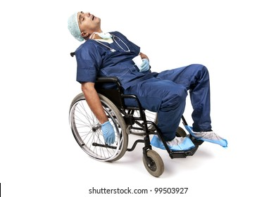 Tired doctor sleeping in a wheelchair