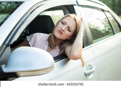 A tired driver is waiting for passage the car