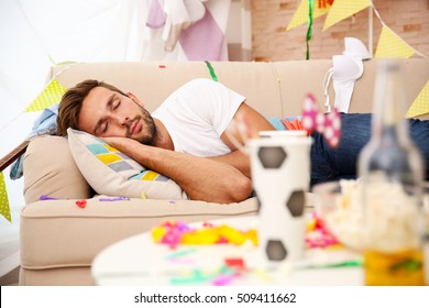 Tired drunk man after party at home