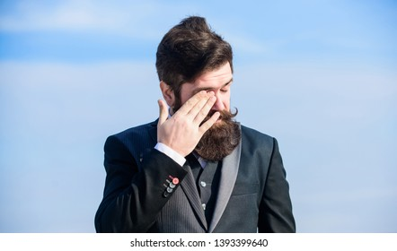 tired employer touch face. Businessman against the sky. brutal caucasian employer with moustache. Mature hipster employer with beard. Future success. Male formal fashion. Bearded man employer.