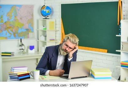 Tired enough. Senior teacher take nap in classroom. Bearded man sleep at school. Nap or daydream. School break and rest. Nap time. Being exhausted and overworked. Short nap is always good idea.