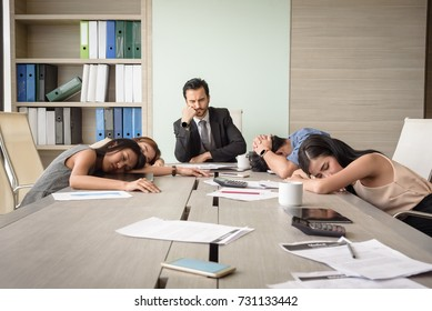 tired exhausted young business man and woman sleeping in meeting room at office